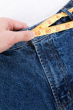 Weight loss. A blue jean and ruler, concept of weight loss Royalty Free Stock Photography