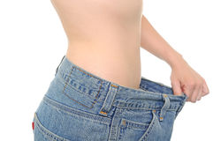 Weight loss. A belly and big jeans showing weight loss Stock Photos