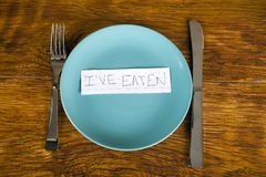 Weight loss and anorexia concept eaten message on plate. Weight loss concept eaten message on plate Stock Images