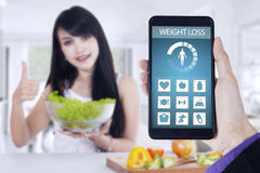 Weight loss app and woman holds salad Stock Photography