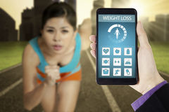 Weight loss app and woman running at field Royalty Free Stock Photo