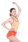 Weight loss concept. Cheerful young exercising woman, isolated o Stock Images
