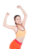 Weight loss concept. Cheerful young exercising woman, isolated o. Ver white background Royalty Free Stock Photo
