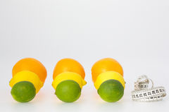 Citrus Fruits and Measuring Tape Royalty Free Stock Images