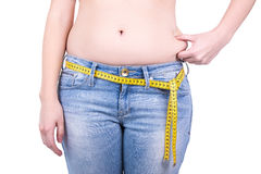 Weight loss concept - close up of overweight woman's belly and m royalty free stock photography