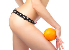 Weight loss concept Hip, legs, abdomen and orange Royalty Free Stock Images
