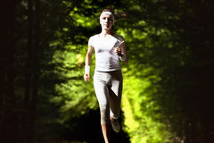 Weight loss concept, spotr concept, healthy lifestyle concept. Running woman on green blurred background. royalty free stock photo