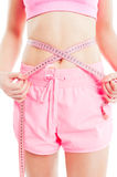 Weight loss concept with woman measuring waist Stock Photo