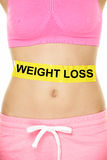 Weight loss concept - Woman waist lower body. Weight loss concept - Woman waist and belly lower body crop with text on yellow label showing the words written for Royalty Free Stock Photos