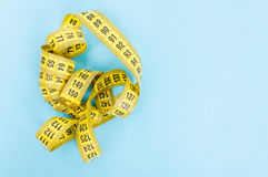 Weight loss concept with yellow centimeter Royalty Free Stock Photo