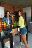 Weight Loss Diet. Healthy Eating Women Drink Smoothie In Kitchen stock photo