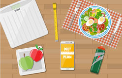 Weight loss, diet, healthy lifestyle. Wooden desk with late of salad, scales, inch roulette, phone app to diet, sports water, apples. weight loss, diet, healthy Stock Photos