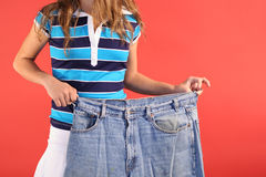 Weight loss fat jeans. Photo of weight loss fat jeans Royalty Free Stock Photo