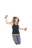 Weight loss fitness female model in jump flexing royalty free stock photo