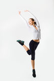 Weight loss fitness woman jumping of joy. Caucasian female model Stock Photo