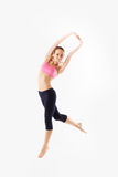 Weight loss fitness woman jumping of joy. Caucasian female model Royalty Free Stock Photography
