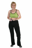 Weight Loss at Forty. Attractive forty year old woman in workout attire with measuring tape royalty free stock photography
