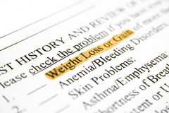 Weight loss or gain. Close up of health history form - weight loss or gain Stock Photo