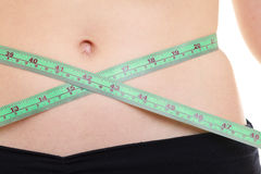 Weight loss. Green measuring tape on woman body Royalty Free Stock Image