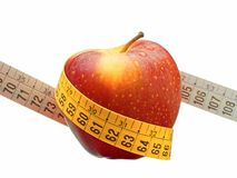 Weight loss and healthy dieting concept red apple measuring tape isolated Stock Photos