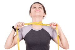 Weight loss hispanic woman smiling with measuring Royalty Free Stock Photos