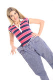 Weight loss jeans blonde Stock Photo