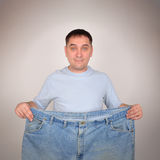 Weight Loss Man Holding Big Pants Royalty Free Stock Photos