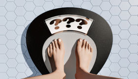 Weight mystery. Womans feet on bathroom scale Royalty Free Stock Image