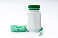 Weight loss pills. With measuring pills Stock Photography