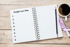 Weight loss program written on book with black listing, planning conceptual stock photography