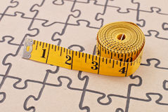 Weight Loss Success Concept. Tape Measure On Completed Blank Puzzle Royalty Free Stock Photo