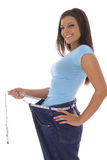 Weight loss success with measuring tape belt. Shot of weight loss success with measuring tape belt royalty free stock photos