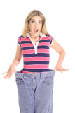 Weight loss surprise jeans Royalty Free Stock Photo