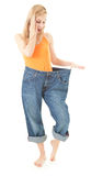 Weight loss - surprised young woman Royalty Free Stock Photography