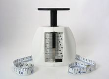 Weight Loss Tools. One pound food scale and measuring tape Royalty Free Stock Photos