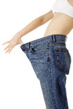 Weight Loss Woman. Isolated on white background Royalty Free Stock Images