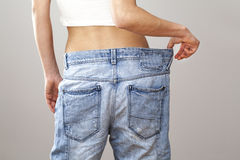Weight loss woman with bluejeans Stock Photo