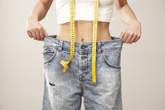 Weight loss woman with bluejeans royalty free stock images