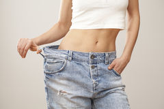 Weight loss woman with bluejeans Stock Photography