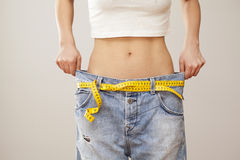 Weight loss woman with bluejeans. Weight loss woman with  bluejeans Royalty Free Stock Images
