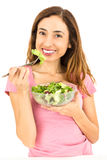 Weight loss woman eating salad. Woman on diet is eating a bowl of salad. Isolated on white background Stock Image