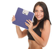Weight loss woman on scale happy. On scales over white Stock Images