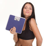 Weight loss woman on scale happy Stock Photos