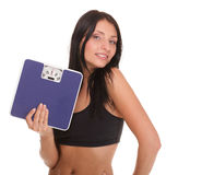 Weight loss woman on scale happy Stock Photo