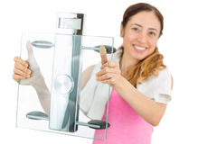Weight loss woman showing scale. Happy diet woman showing scale. Isolated on white background Royalty Free Stock Photos