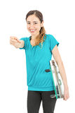 Weight loss woman smiling and pointing at the camera. Smiling caucasian attractive woman pointing at the camera and holding a scale under her arm. Isolated on Royalty Free Stock Image