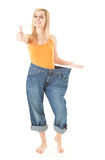 Weight loss woman with thumb up Royalty Free Stock Image
