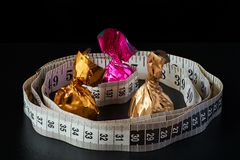 Weight loss is your choice slim waistline or candy stock photo