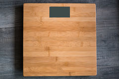 Weight machine. Wooden digital weight machine with wooden background Royalty Free Stock Image