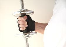 Weight in man's hand Stock Image